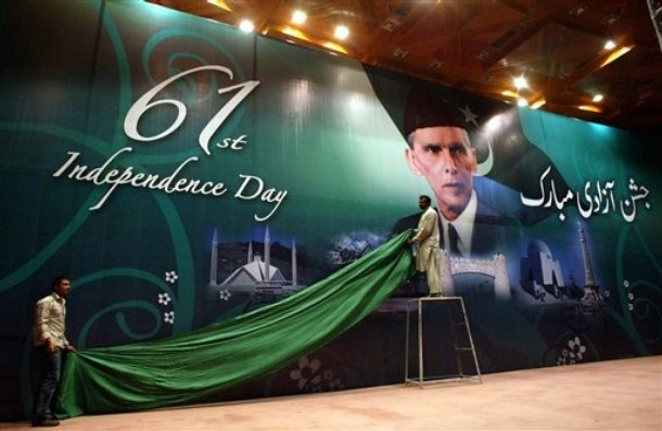 Pakistani workers fix a cloth over a billboard showing the portrait of founder of Pakistan, Mohammed Ali Jinnah in preparation for the upcoming Independence Day ceremony, Saturday, Aug. 11, 2007 in Islamabad, Pakistan. Pakistani nation will celebrate its Independence Day on Aug. 14, to mark its independence from the British rule in 1947. The word on the board at right reads Happy Impendence Day.\'
